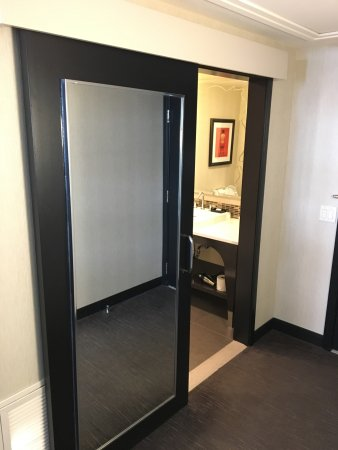 thewit a doubletree by hilton full length mirror on sliding bathroom door
