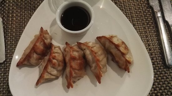 Hoku: Gyoza, Pork filled dumplings, served with a vinegar-soy sauce and chili oil
