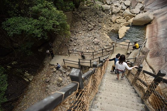 Dehua County, China: climbing down the steps after viewing the waterfall