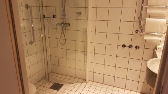 Bathroom with shower water all over the floor - Picture of Scandic ...