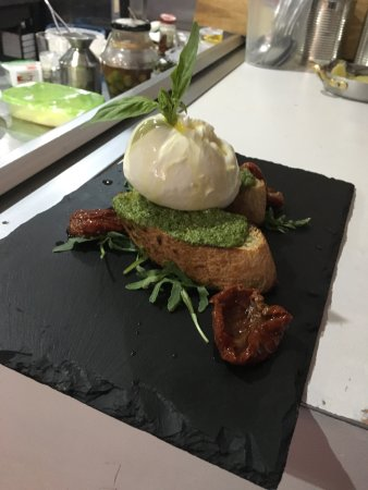 Cleckheaton, UK: Fresh burrata cheese with pesto and crostini bread - fillet of seabass