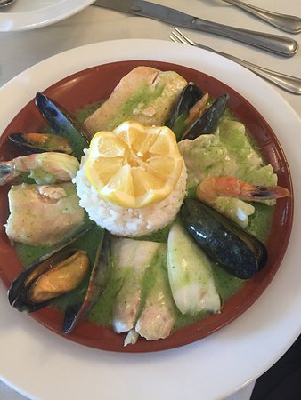 Seafood special in delicate green sauce