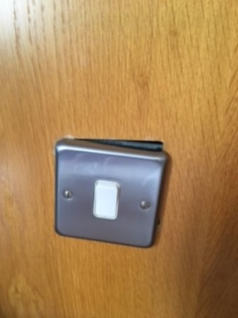 Gleneagle Hotel: this is the light switch in my room . easy fix for most hotels .