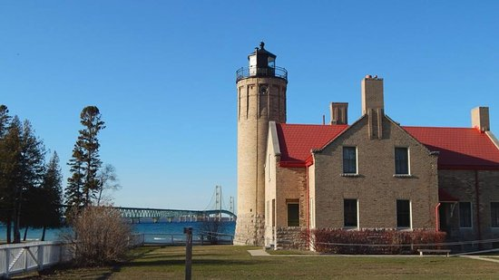 Mackinaw City, MI: View of the lighthouse with the Mackinac Bridge in the background