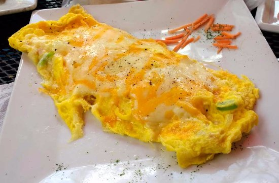 A Touch of Cuba Restaurant : Scrambled eggs with ham, onions, green pepper and cheese.