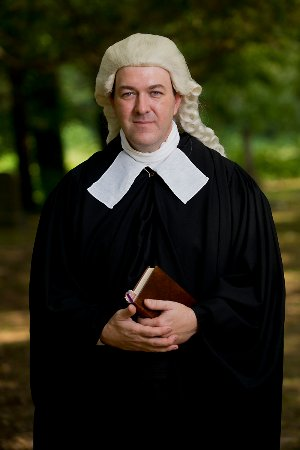 Smithfield, VA: A living historian portraying a 1680s rector during the 17th-century living history event.