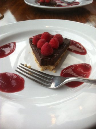 Avila Beach, CA: DF/GF chocolate tort with raspberry reduction and cashew crust