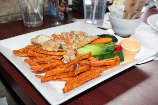 Ajax, Canada: Grilled Tilapia over sweet potato fries and a side of veggies