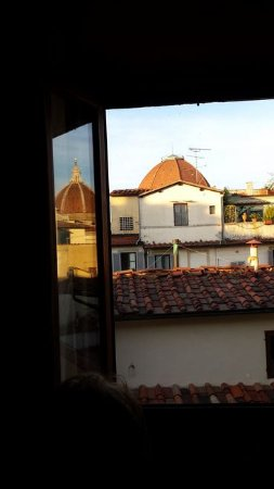 Hotel Delle Tele : The domes of San Lorenzo and the Duomo (reflected) compete for attention.