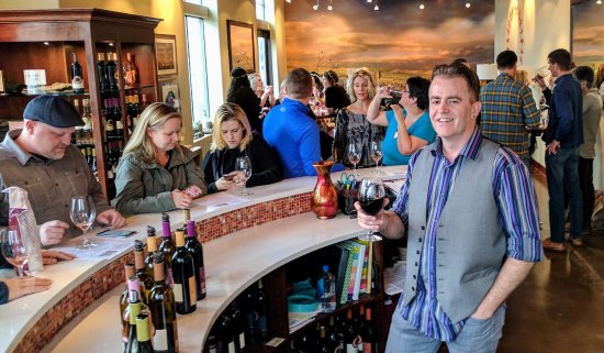 Dundee, OR: Eric seeks refreshment while managing the crowd on a busy day in the tasting room.