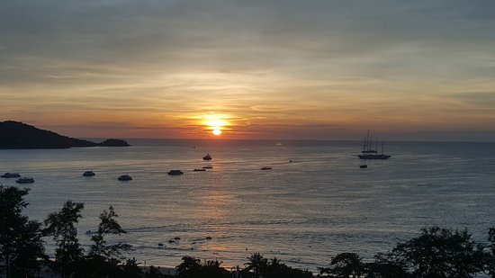 Patong Tower Holiday Rentals: Sunset at Patong Beach from room 1402S