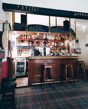 Blackwaterfoot, UK: the cosy Black Grouse bar with great selection of beers and whiskies, and open fire.