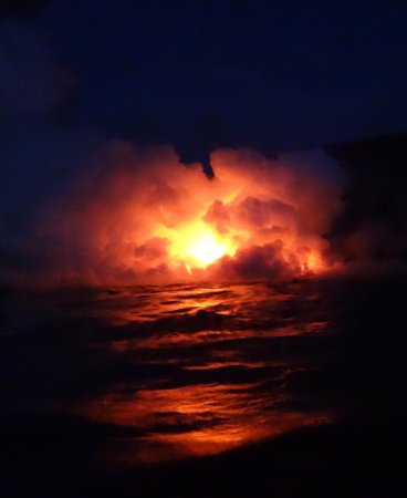 Pahoa, HI: Lava exploding as waves crash in