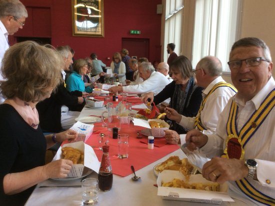 Norton Fitzwarren, UK: The Taunton Deane Morris Men tuck into lunch on Easter Monday