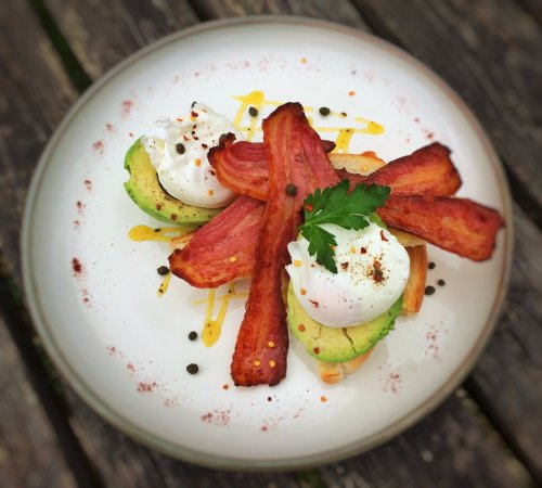 Polbathic, UK: Streaky bacon, avocado and poached free range eggs on sourdough