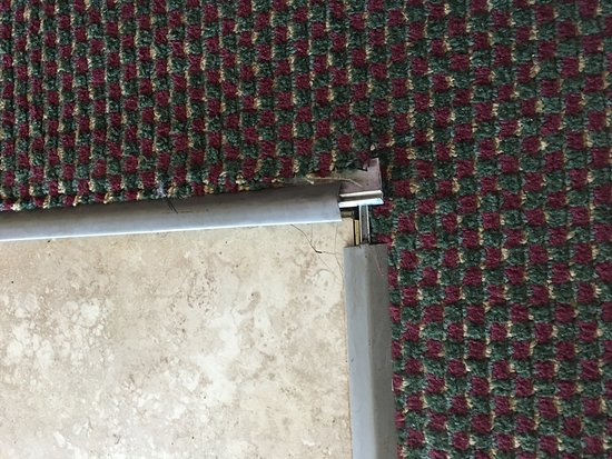 Athens, AL: Very sharp metal sticking up in our room
