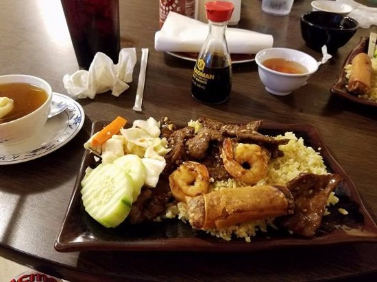 Fulton, TX: Stir fried beef and shrimp over fried rice with cucumber,lettuce and carrot salad
