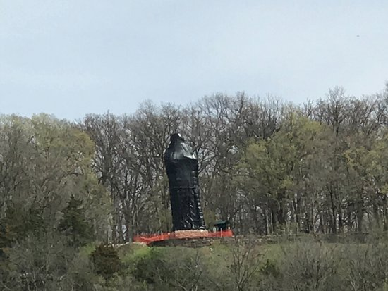 Oregon, IL: The wrapped statue as viewed from across the Rock river.