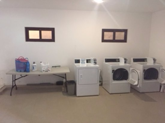Residences El Faro: Laundry facility at ground floor in the complex. Works with a token - to be purchased at front d