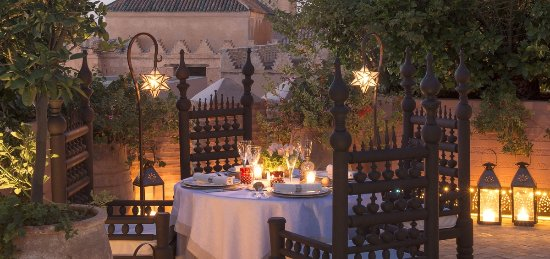 Rooftop dinning at La Sultana Marrakech over the Medina and historical monuments