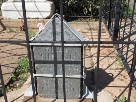 Fort Sumner, NM: Like Billy the Kid in life, the tombstone is behind bars.
