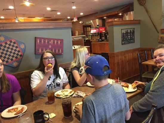 Casper, WY: A group of hungry teens loving Pizza Ranch!