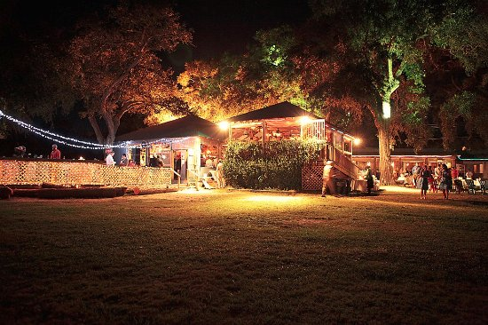Night time photo of the yard and gazebo light up hot for Hot fish club