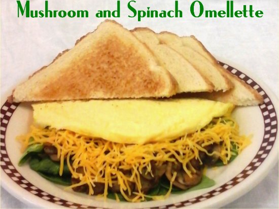 Bellefontaine, OH: our fluffy three egg omelette with grilled mushrooms, fresh baby spinach and shredded cheddar ch