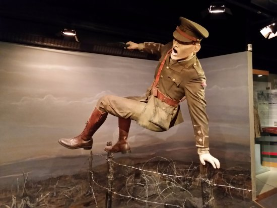 The Military Museums : WWI officer hops the German wire to silence machine gun.