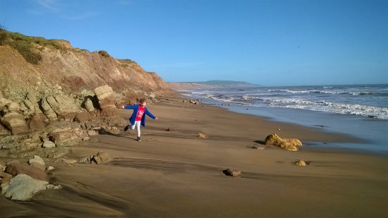 Brighstone, UK: My daughter on the beach at Blighstone