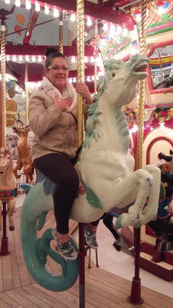 Seaside, OR: riding a mermaid on the carousel...