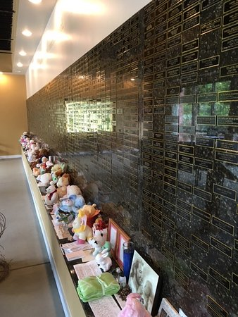 National Memorial for the Unborn: Just part of the wall of plaques to aborted babies, along with letters, notes, and gifts.