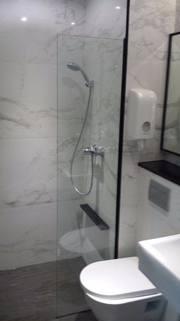 Small bathroom - Picture of Hotel Boss, Singapore - TripAdvisor on tiffany blue and gray bathroom, soft blue and gray bathroom, teal bathroom ideas, royal blue and gray bathroom, sky blue and gray bathroom, espresso and gray bathroom, gray and yellow bathroom, almond and gray bathroom, teal painted bathroom, teal colored bathrooms, black and white decor for a bathroom, purple and gray bathroom, white and gray bathroom, dark green and gray bathroom, silver blue and gray bathroom, powder blue and gray bathroom, teal bathroom cabinets, olive green and gray bathroom, black and gray bathroom, brown and gray bathroom,
