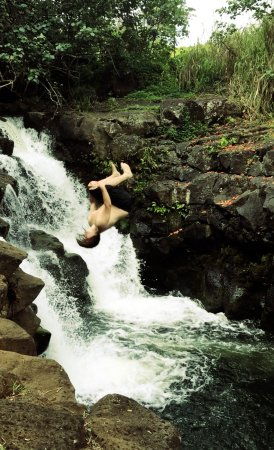 Lawai, Hawái: Son #1 backflipping into waterfalls
