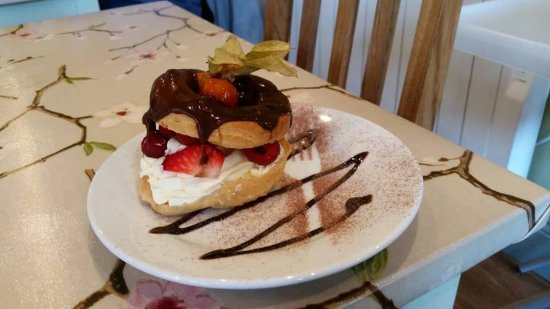 Tansley, UK: Paris-Brest Choux pastry filled with Gran Marnier and Cognac cream, fresh fruit and topped with