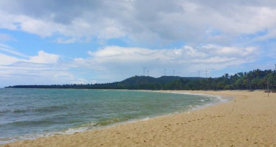 the beach and some wind turbines atop the Pagudpud higlands