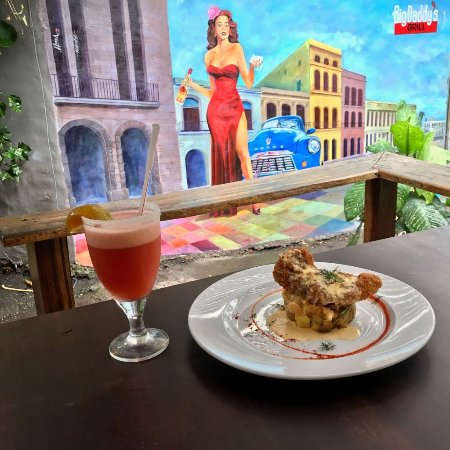 Big Daddy's Grill: Parmesan encrusted Snapper with a Lobster Cream Sauce, enjoy it with a strawberry margarita!!