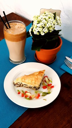 Ellesmere, UK: Spanakopitta with a Frappe (Ice Coffee). Lovely Spinach and Feta pie. Perfect summer combination