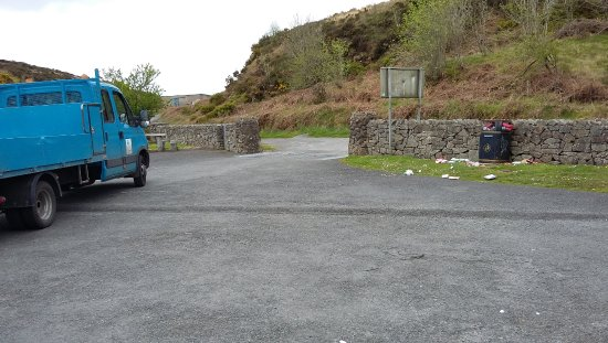 Newry, UK: Bins full and rubbish all over the place. Council workers sat and ignored the mess.