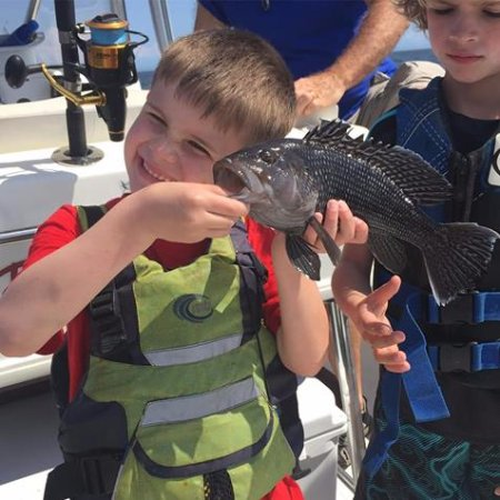 Southport, NC: Look at the smile on that little guys face with his black Sea Bass!