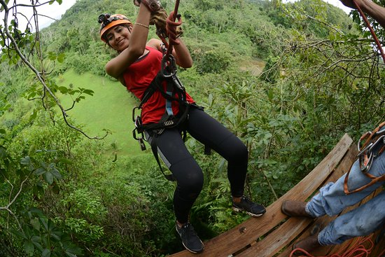 Zip lining at Caves Branch Outpost