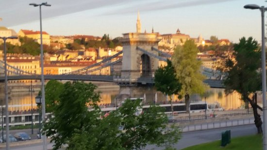Sofitel Budapest Chain Bridge: A photo taken at sunrise from out room the sun made the buildings all look golden, stunning
