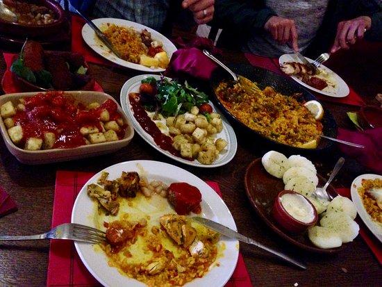 Acle, UK: Potato brava, chicken skewer, potato garlic, paella.