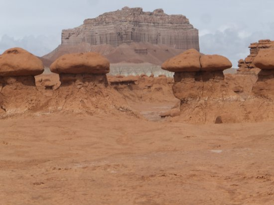 Goblin Valley State Park: Mushroom like sandstone formations with the mountain in the background