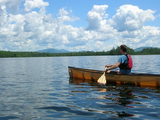 Solo canoeing on Middle Saranac Lake.