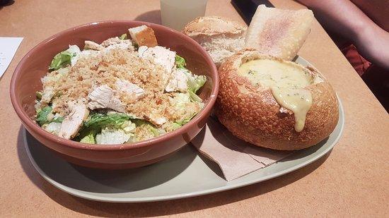 Palm Beach Gardens, FL: broccoli cheddar bread bowl and half chicken caesar salad
