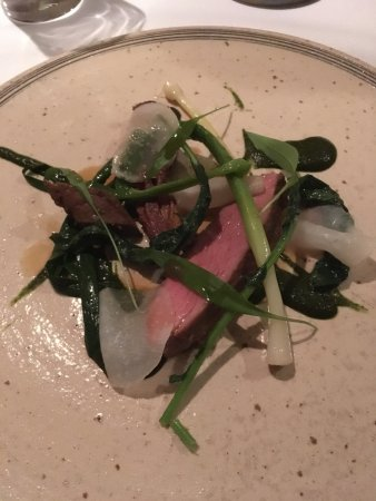 Whitebrook, UK: ryeland lamb with young leeks, turnip, brassica tops and damsons