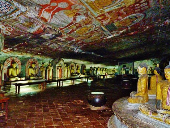 Dambulla, Sri Lanka: Meditating Buddha statues and ancient paintings in the cave temple