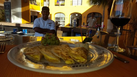 Tesoro Los Cabos: Chicken Enchiladas with the chef looking on.