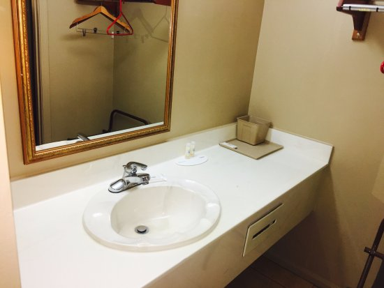 Villa Rica, GA: Pleasant sink with a place to hang clothes on a side.